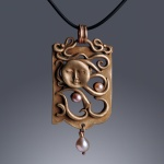 Moondream pendant by Jonna Faulkner. Jewelry photography by Steve Rossman
