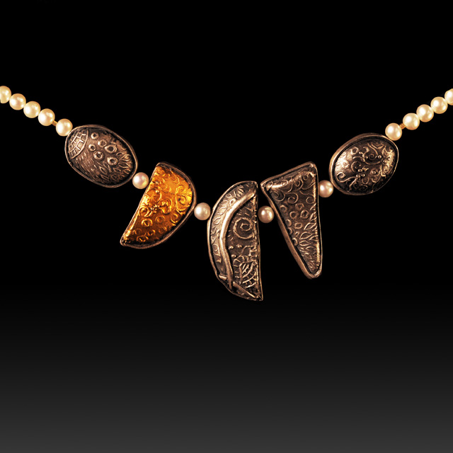 5 hollow forms necklace by Jonna Faulkner. Workshop sample photo by Steve Rossman