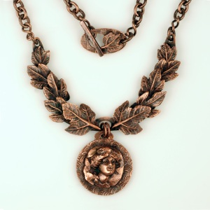 Copper medallion necklace in an ancient theme by Jonna Faulkner. Photo by Steve Rossman.
